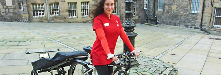 Donna riding to work for her next reflexology session in Edinburgh Royal Mile